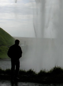 Me behind Seljalandsfoss waterfall in Iceland