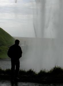 Me behind Seljalandsfoss waterfall in Iceland